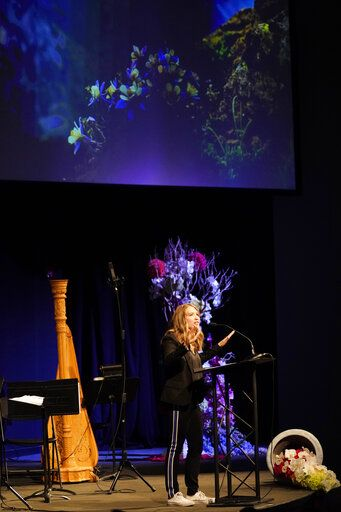 Crystal Woodman-Miller, who was a student at Columbine High School at the time of the massacre, speaks during a faith-based memorial service for the victims of the killing spree at the school nearly 20 years earlier, at a community church, Thursday, April 18, 2019, in Littleton, Colo. (Rick Wilking/Pool Photo via AP)