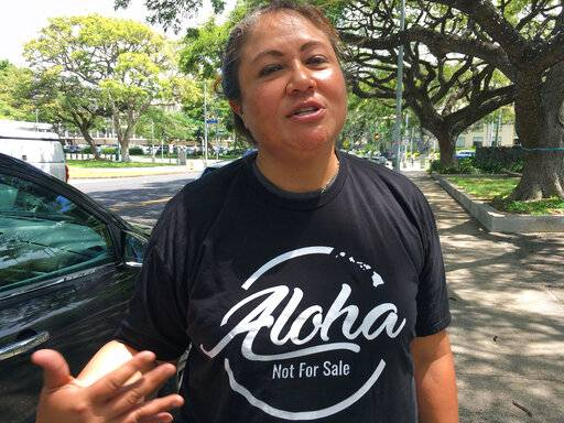 "This Friday, April 12, 2019 photo shows Healani Sonoda-Pale, chairwoman of the Ka Lahui Hawaii political action committee, wearing a T-shirt saying ""Aloha Not for Sale"" in Honolulu. Hawaii lawmakers are considering adopting a resolution calling for the creation of legal protections for Native Hawaiian cultural intellectual property."
