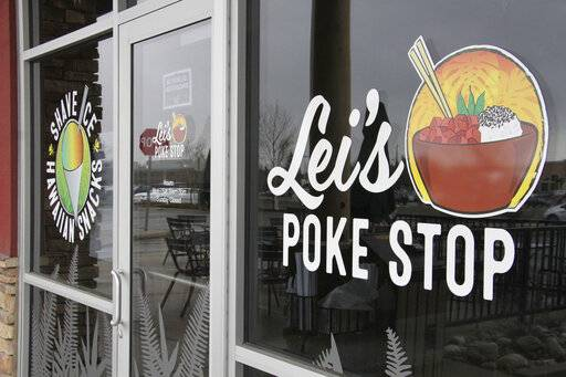 "The exterior of Lei's Poke Stop is seen Wednesday, April 17, 2019, in Anchorage, Alaska. Hawaii lawmakers are considering adopting a resolution calling for the creation of legal protections for Native Hawaiian cultural intellectual property. The move comes after a Chicago restaurant chain owner shocked the island state by trademarking the name ""Aloha Poke"" and sending letters to similarly named cubed fish shops around the country demanding that they change their names, including this Anchorage store, which changed its name."