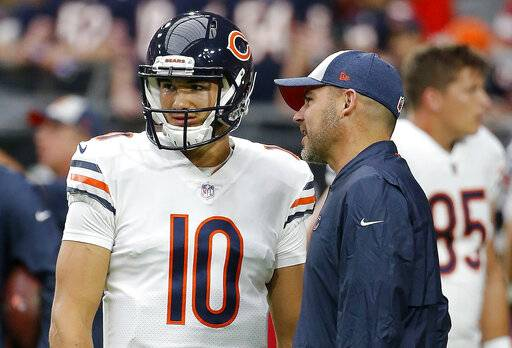 FILE - In this Sept. 23, 2018, file photo, Chicago Bears quarterback Mitchell Trubisky (10) talks with Bears head coach Matt Nagy, right, prior to an NFL football game against the Arizona Cardinals in Glendale, Ariz. The Bears are eyeing the draft from a different perch. A worst-to-first jump last season left them staring down at the rest of the NFC North, armed and loaded with one of the league's best defenses and banking on a more creative offense led by Trubisky to improve in Nagy's second season. (AP Photo/Rick Scuteri, File)