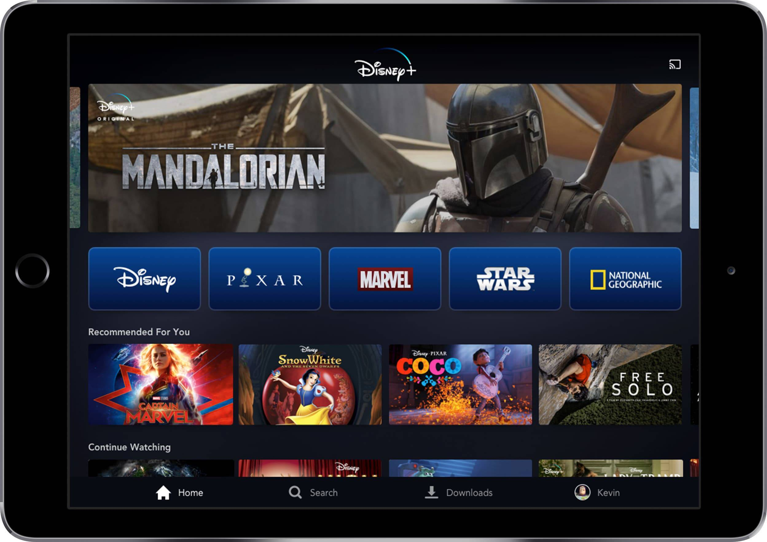 "This image provided by Disney shows the Disney+ home screen on a tablet, featuring the new ""Star Wars"" TV series, ""The Mandalorian,"" across the top."