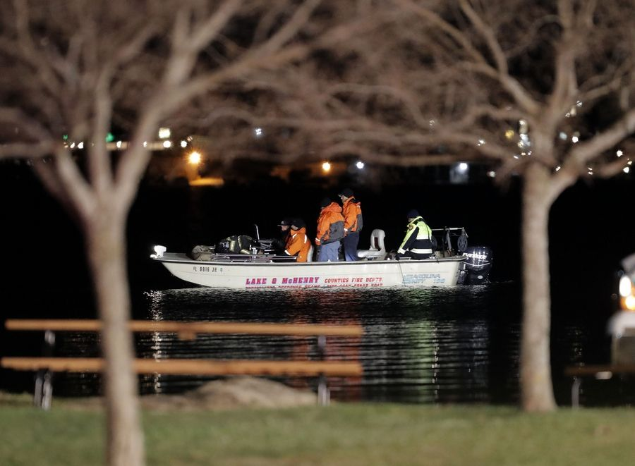 Rescuers search for a missing 9-year-old boy who fell off a paddleboard Friday night on Bangs Lake in Wauconda. A 10-year-old child, who also fell, was rescued by a passing fisherman.
