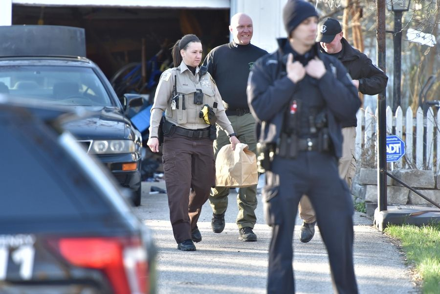 "Cook County Sheriff's police carry a bag Friday from the Dole Ave. home of Andrew ""AJ"" Freund, 5, who was last seen Wednesday night in Crystal Lake."