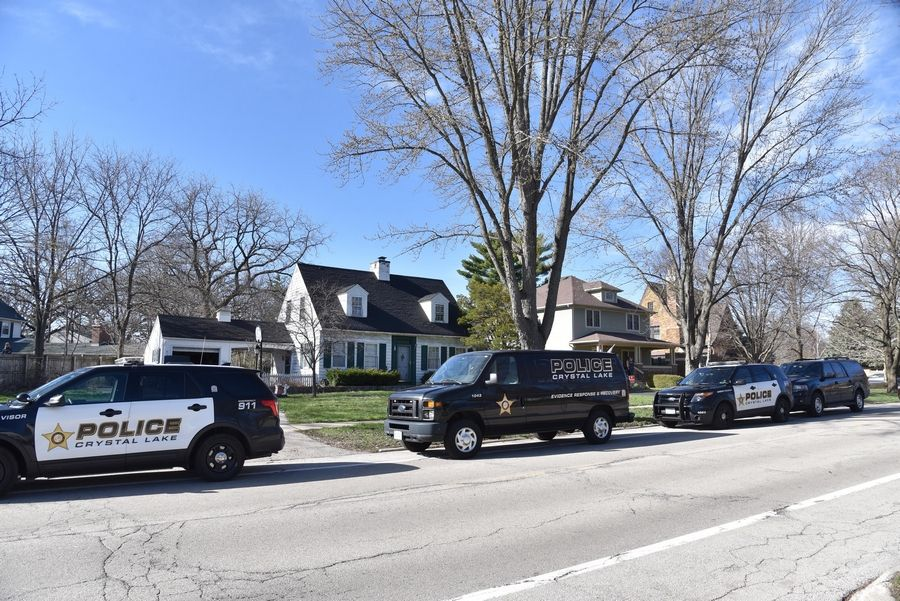 "Several Crystal Lake police vehicles park outside Friday at the home of Andrew ""AJ"" Freund, 5, who has been missing since he was last seen Wednesday night at his home on Dole Avenue in Crystal Lake."
