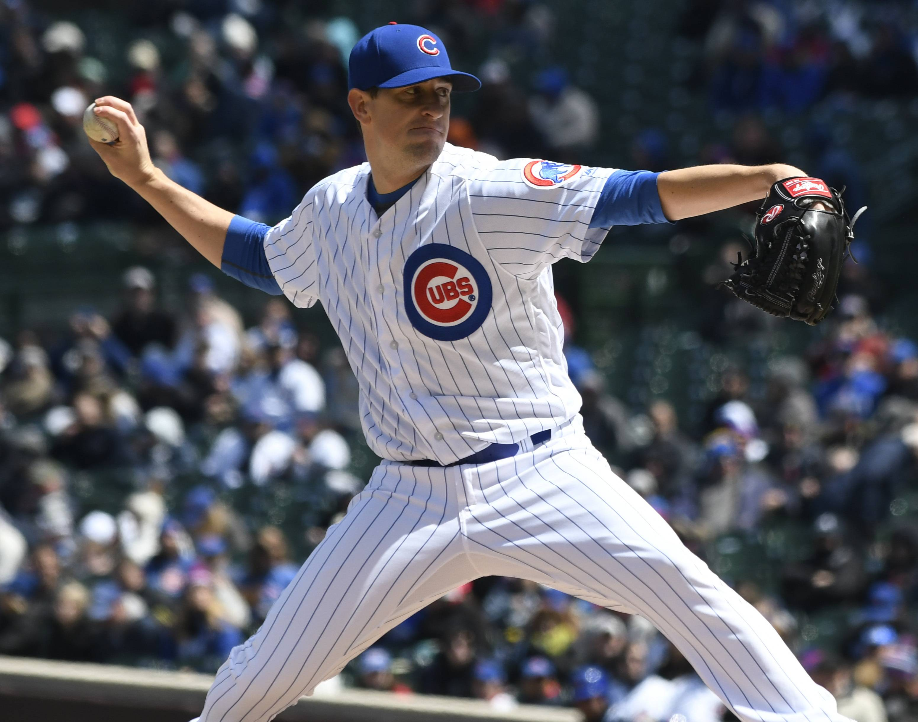 Chicago Cubs starting pitcher Kyle Hendricks (28) throws against the Arizona Diamondbacks during the first inning Friday in Chicago. Hendricks turned in the third straight game of 7 innings without giving up a run, joining Cole Hamels and Jose Quintana. It was Hendricks' first quality start of the season.