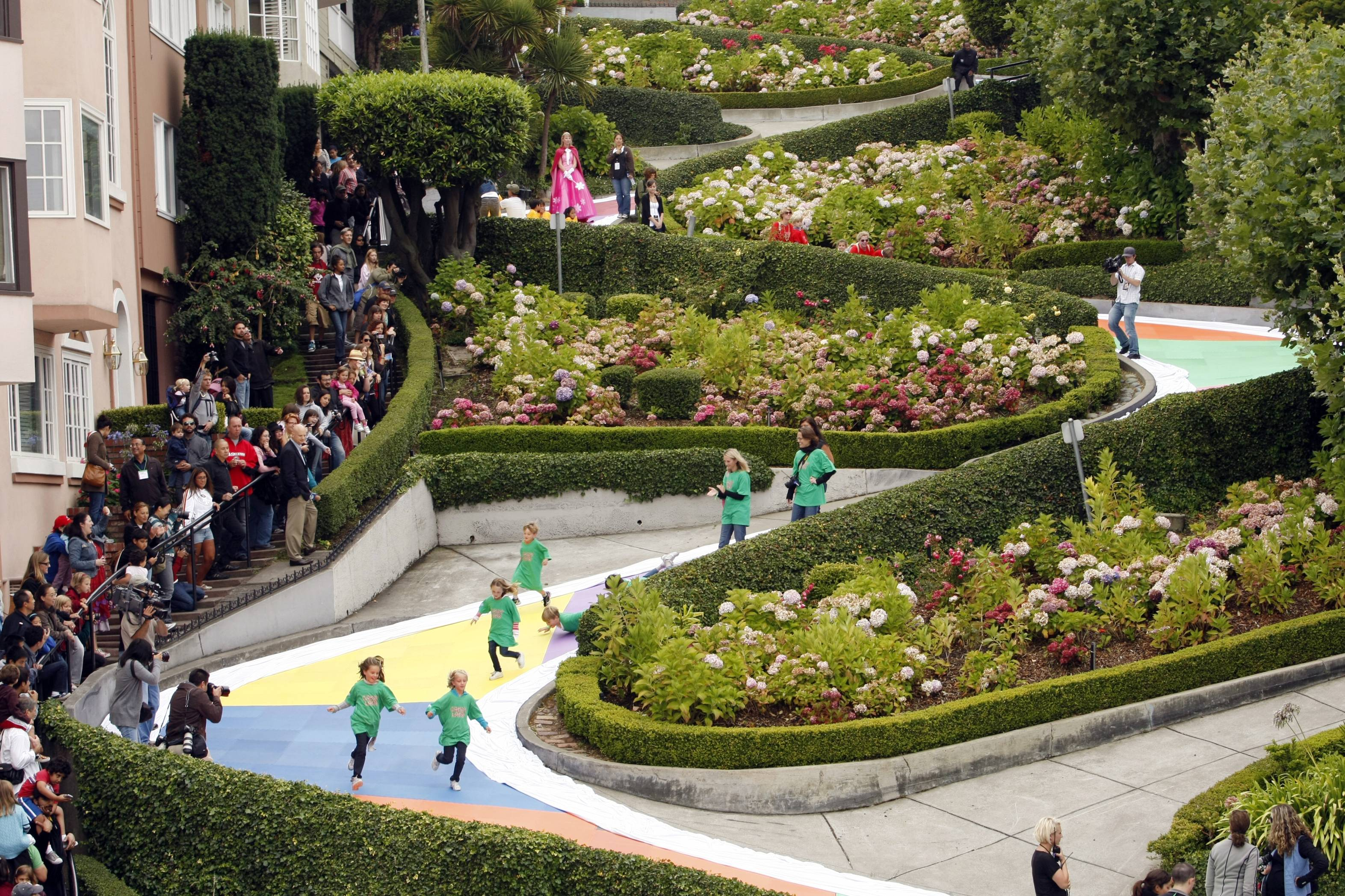 Children run down Lombard Street in San Francisco, which was transformed for the day into a gigantic Candy Land board game to commemorate the game's 60th anniversary.