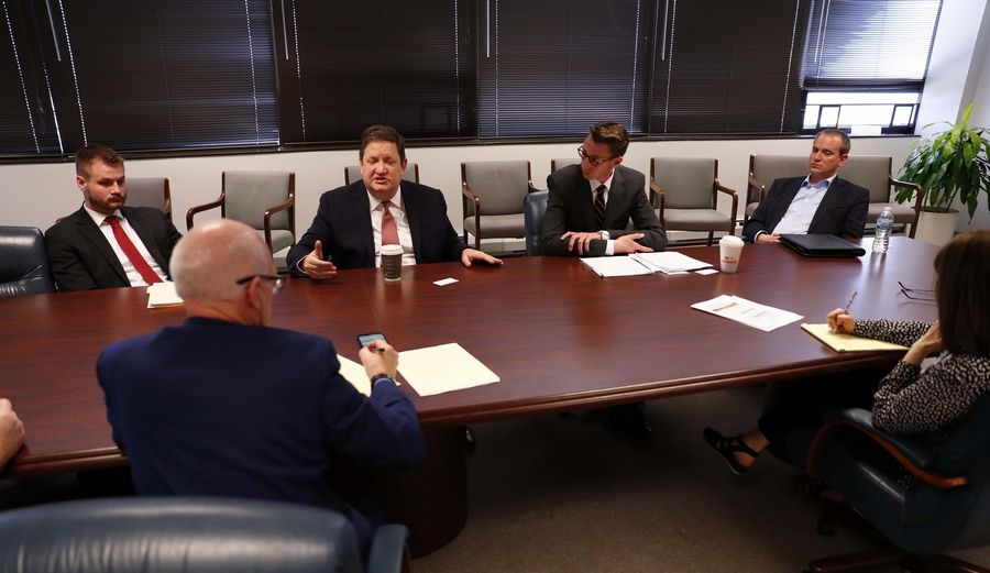 From left, Adam Schuster, director of budget and tax research at the Illinois Policy Institute; state Rep. David McSweeney; Andrew Nelms, Illinois state director of Americans for Prosperity; and Jason Heffley, executive director of Ideas Illinois, speak with Daily Herald editors about their opposition to the graduated income tax.
