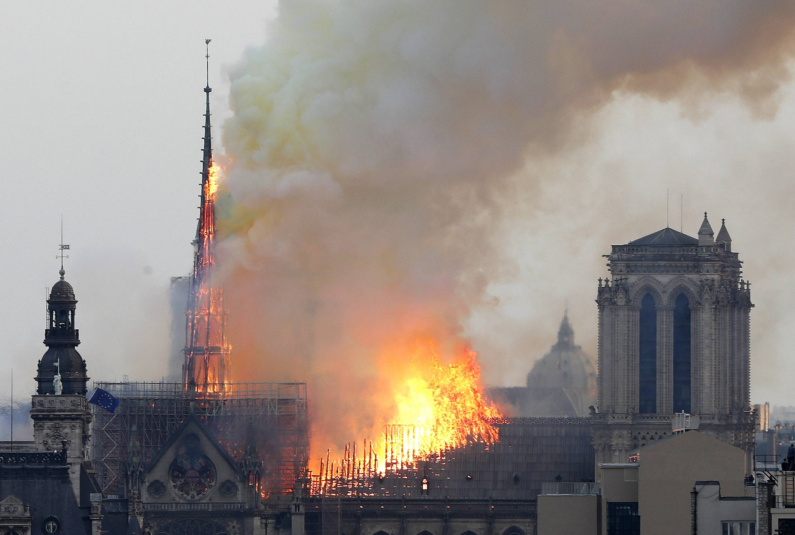 Flames rise from Notre Dame Cathedral as it burns in Paris Monday.