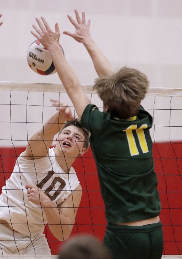 Waubonsie Valley's Ben Jordan, right, blocks the spike of Carmel's Anderson Ptasienski during the Palatine boys volleyball tournament Saturday.