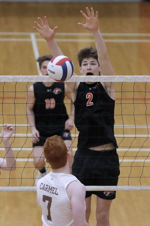 Libertyville's Patrick Graham (2) meets Carmel's Sean Seidl at the net during the Palatine boys volleyball tournament Saturday.
