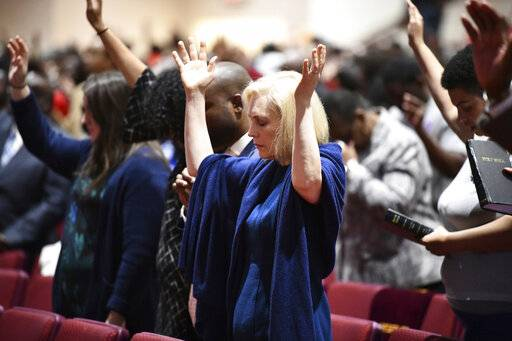 FILE - In this Feb. 10, 2019, file photo, Sen. Kirsten Gillibrand, D-N.Y., worships at Mount Moriah Missionary Baptist Church in North Charleston, S.C. By now, most Democratic presidential candidates have polished their stump speeches. But when they're in South Carolina, they may need to add in a sermon. In a large and diverse primary field, White House hopefuls are angling to develop relationships with black churches.