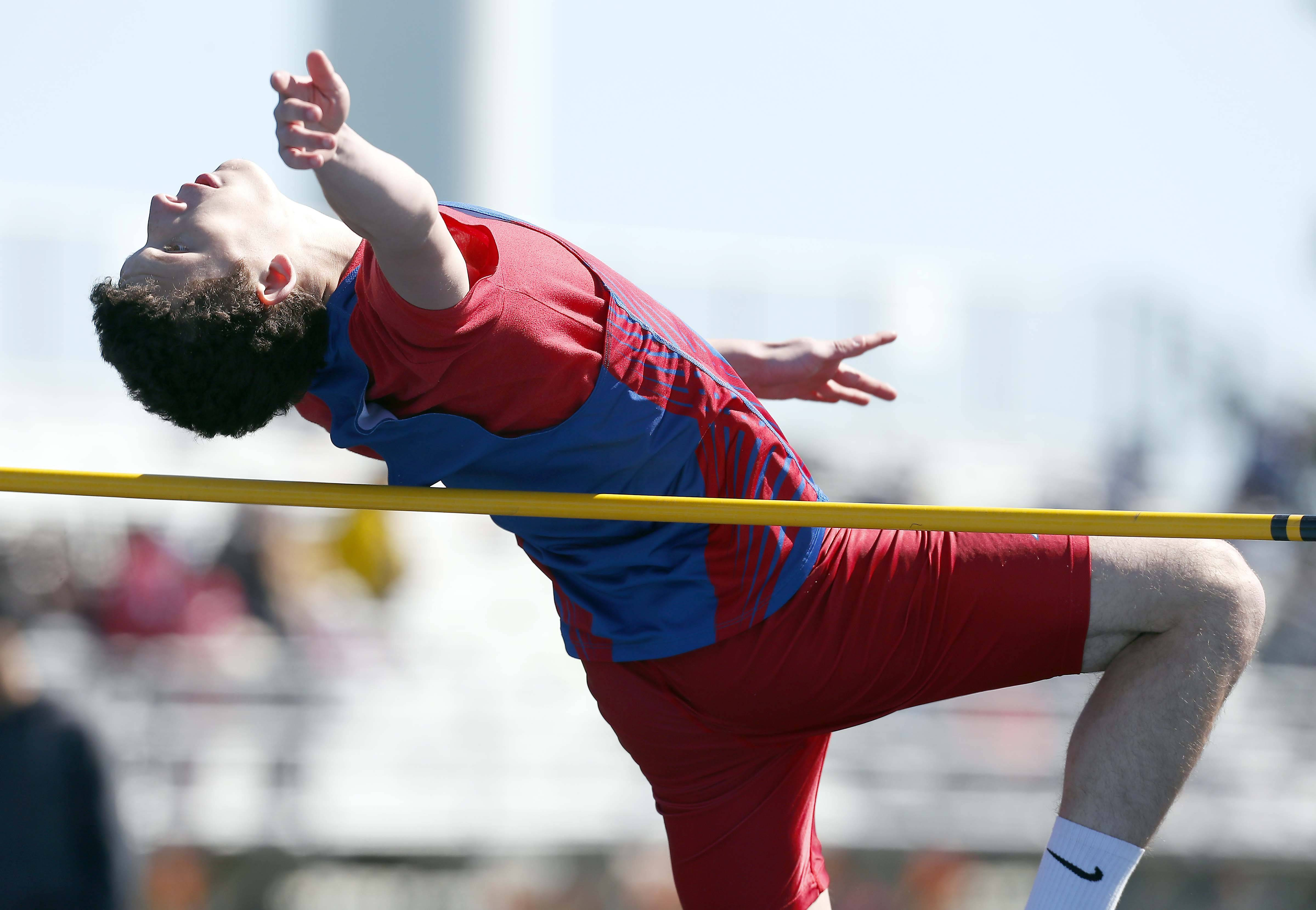 Drew Kastning of Dundee-Crown competes in the high jump.