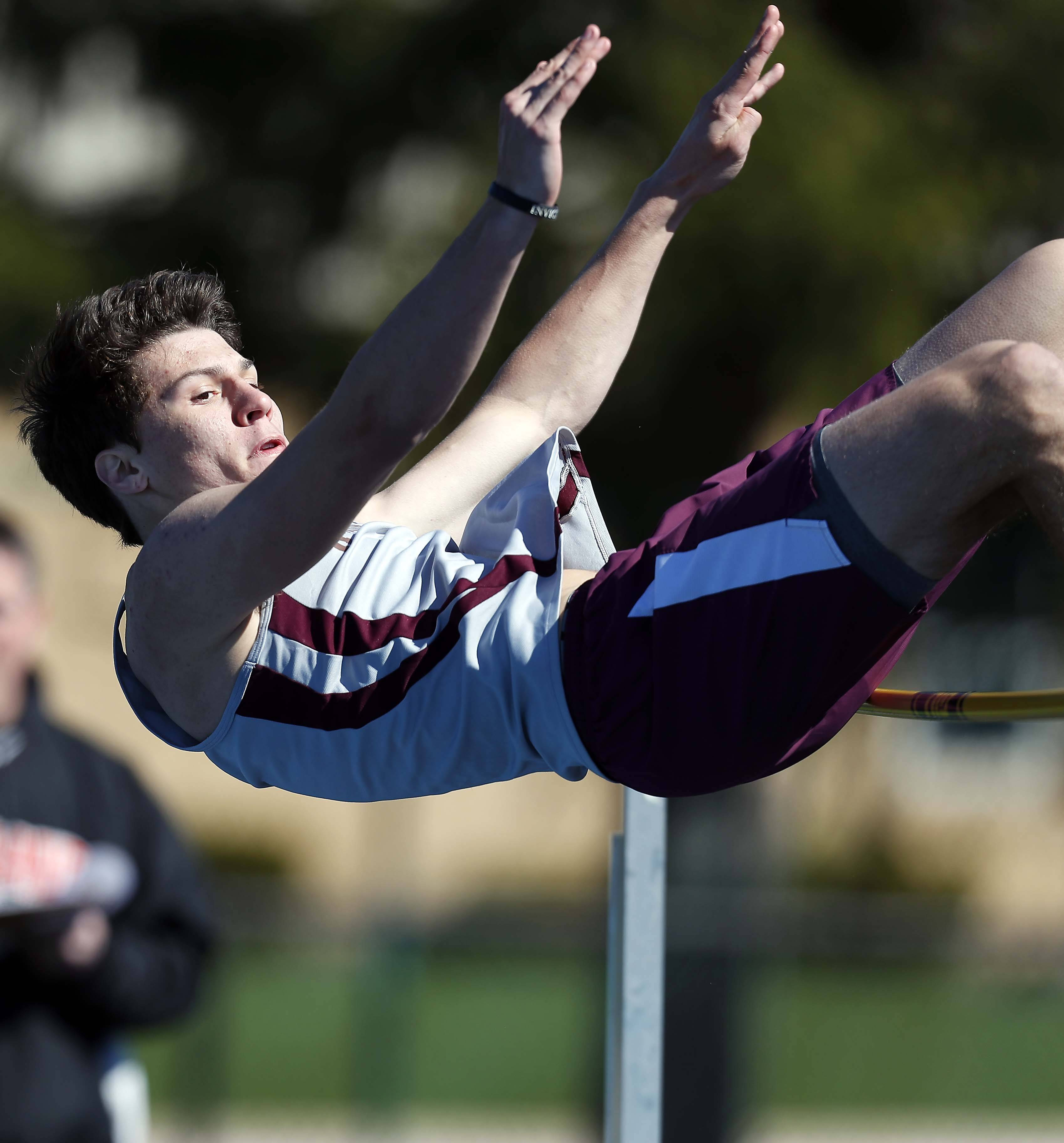 Micah Nichols of Wheaton Academy in the high jump Saturday at the Kaneland Peterson Prep Track Meet in Maple Park.