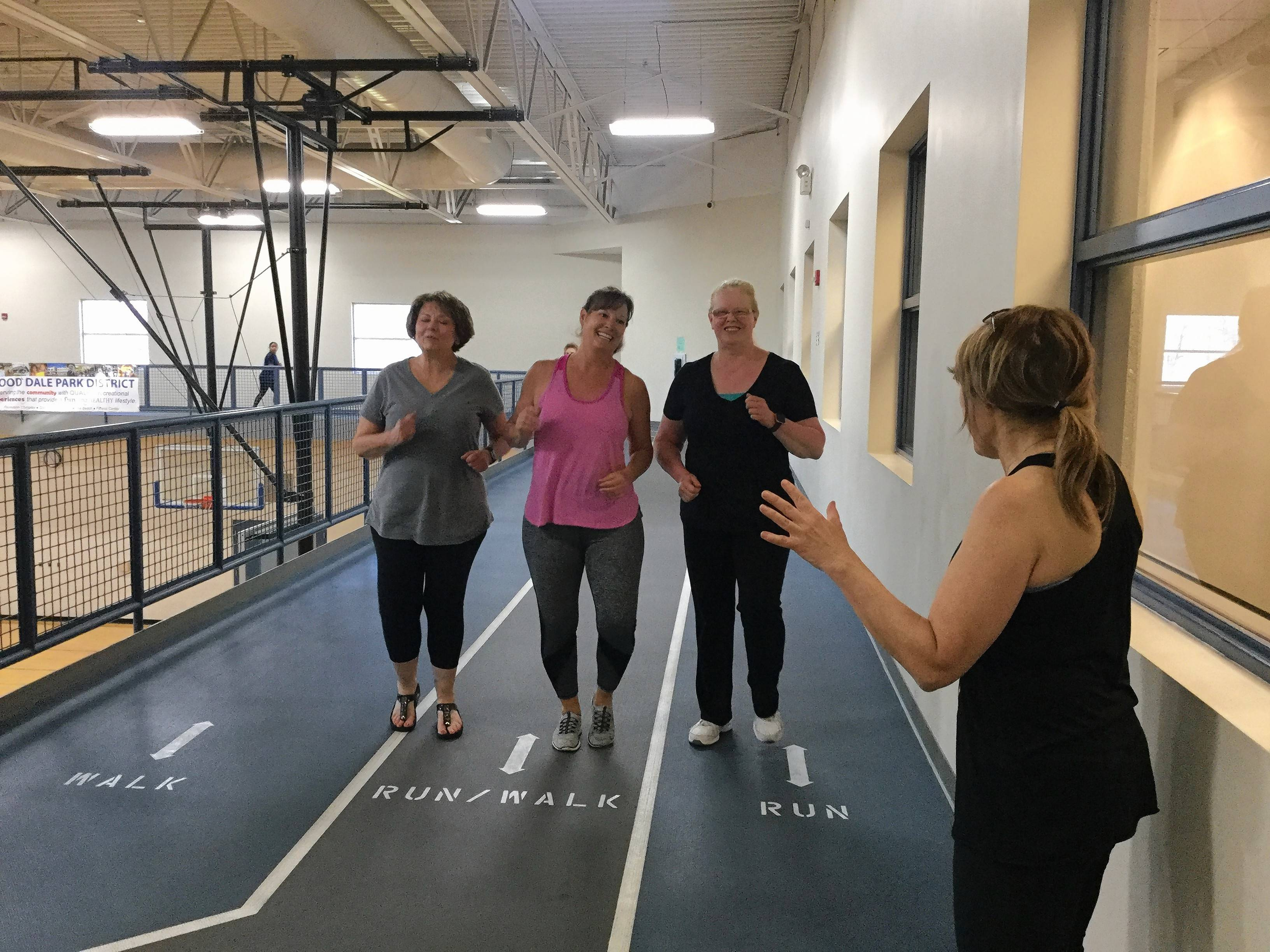 Sue Turco supports her team with words of encouragement as they walk the track at Wood Dale Park District. From left are Sue Turco, Celeste Guadagno, Kathleen Guadagno, and Karen Christopoulos.