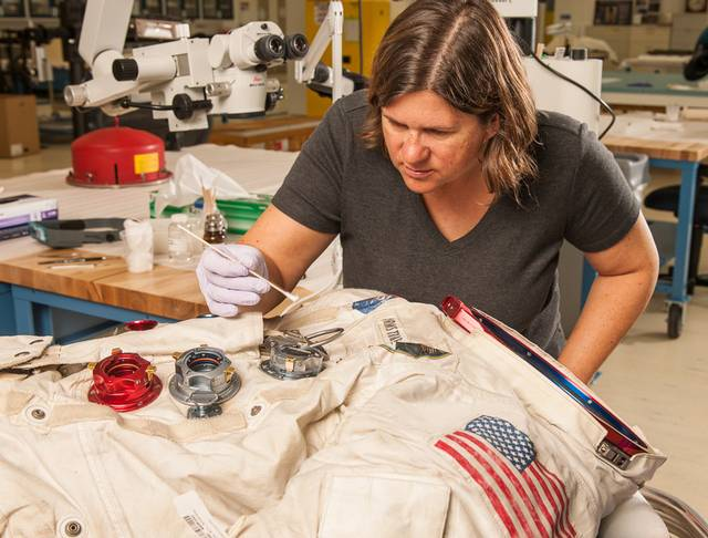 Conservator Lisa Young works on Neil Armstrong's Apollo 11 spacesuit in 2015.