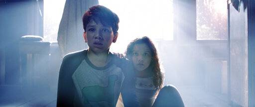 "This image released by Warner Bros. Pictures shows Roman Christou, left, and Jaynee-Lynne Kinchen in a scene from ""The Curse of La Llorona."" (Warner Bros. Pictures via AP)"