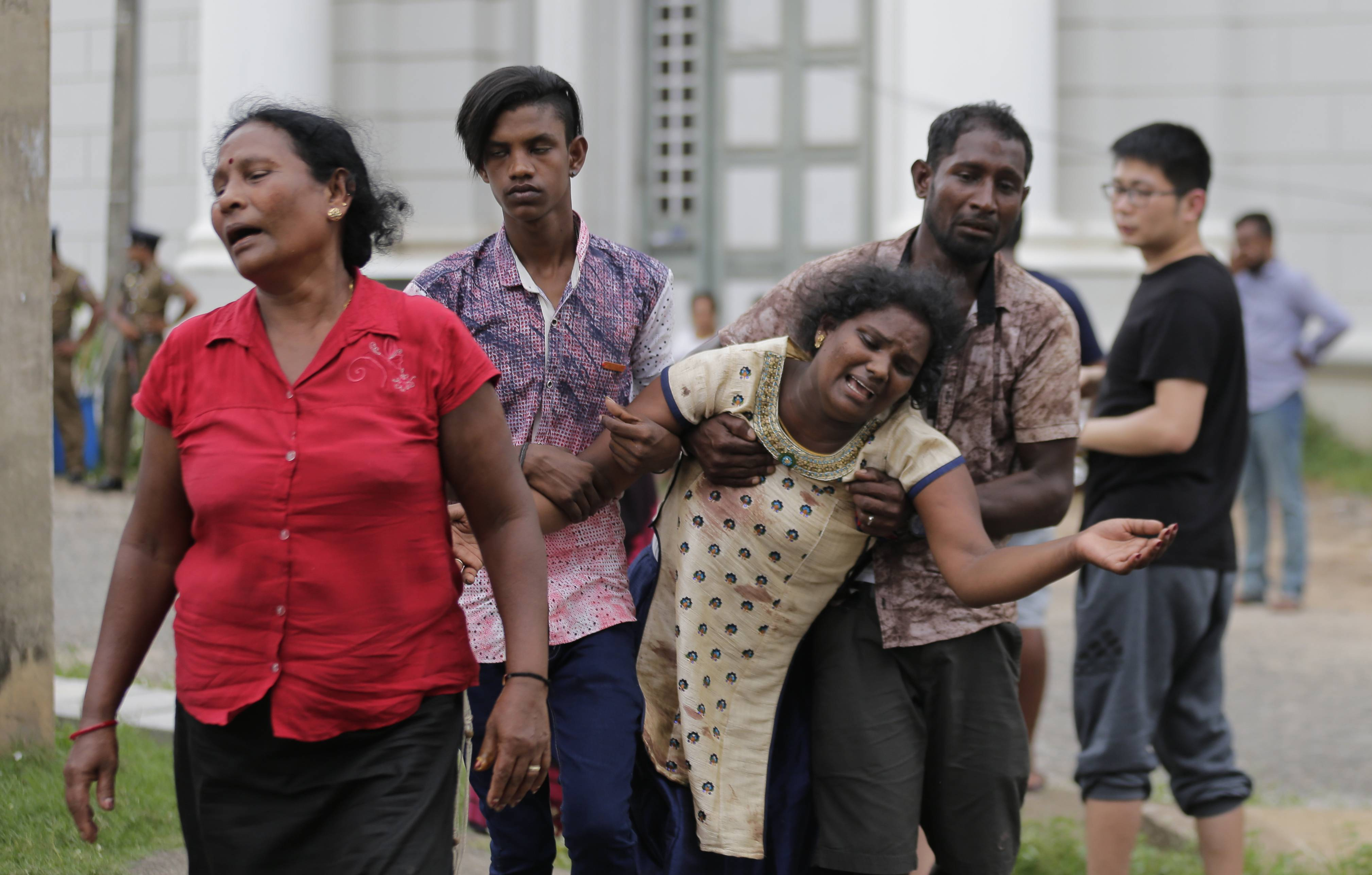 Relatives of a blast victim grieve Sunday outside a morgue in Colombo, Sri Lanka.