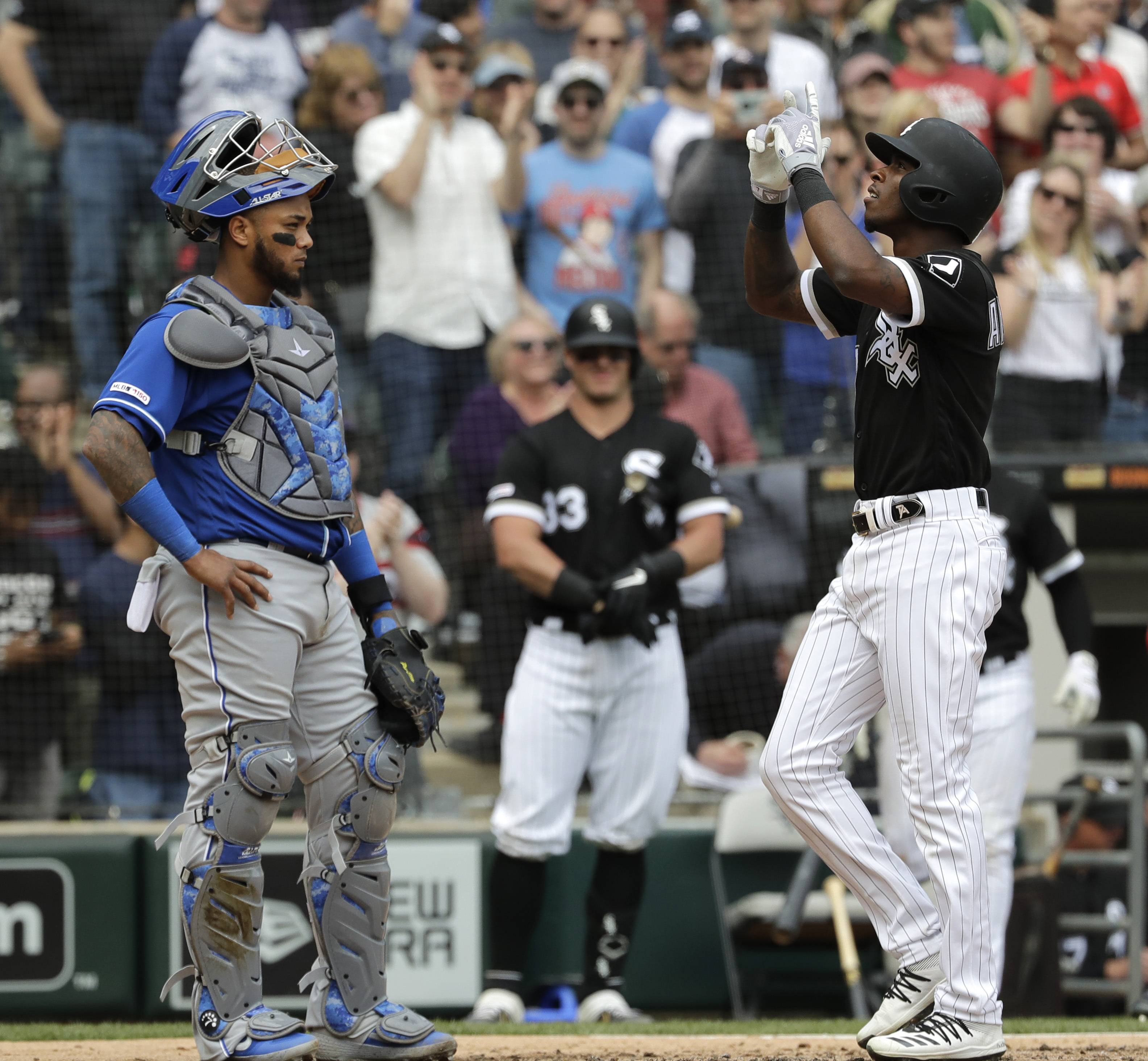 Chicago White Sox's Tim Anderson, right, celebrates after hitting a two-run home run as Kansas City Royals catcher Martin Maldonado looks to the field during the fourth inning of a baseball game in Chicago, Wednesday, April 17, 2019. (AP Photo/Nam Y. Huh)