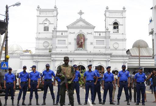 Sri Lankan Army soldiers secure the area around St. Anthony's Shrine after a blast in Colombo, Sri Lanka, Sunday, April 21, 2019. A Sri Lanka hospital spokesman says several blasts on Easter Sunday have killed dozens of people. (AP Photo/Eranga Jayawardena)