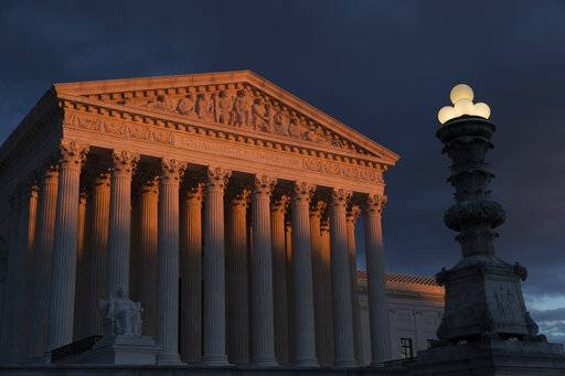 FILE - In this Jan. 24, 2019, file photo, the Supreme Court is seen at sunset in Washington. Vast changes in America and technology have dramatically altered how the census is conducted. But the accuracy of the once-a-decade population count is at the heart of the Supreme Court case over the Trump administration's effort to add a citizenship question to the 2020 census. The justices hear arguments in the case Tuesday, April 23. (AP Photo/J. Scott Applewhite, File)