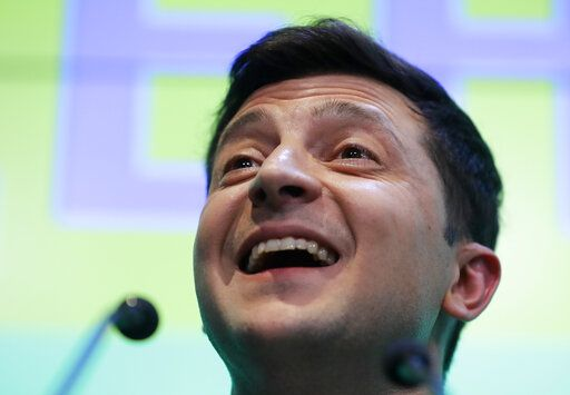 Ukrainian comedian and presidential candidate Volodymyr Zelenskiy speaks to the media and his supporters at his headquarters after the second round of presidential elections in Kiev, Ukraine, Sunday, April 21, 2019. A comedian whose only political experience consists of playing a president on TV appeared poised to reprise the role in real life when an exit poll showed him winning Ukraine's presidential runoff Sunday in a landslide.
