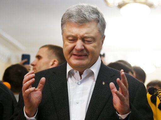 Ukrainian President Petro Poroshenko gestures while speaking to the media at a polling station, during the second round of presidential elections in Kiev, Ukraine, Sunday, April 21, 2019. Top issues in the election have been corruption, the economy and how to end the conflict with Russia-backed rebels in eastern Ukraine.