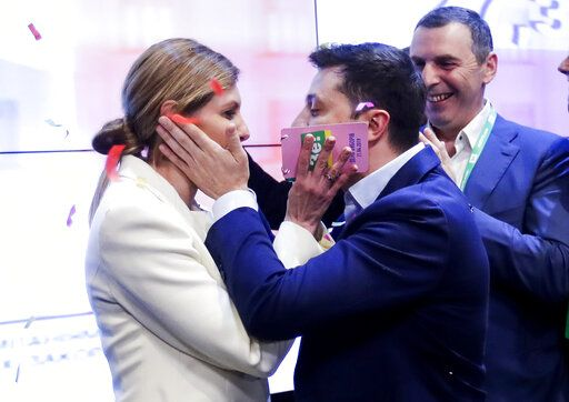 Ukrainian comedian and presidential candidate Volodymyr Zelenskiy, and his wife Olena Zelenska congratulate each other at his headquarters after the second round of presidential elections in Kiev, Ukraine, Sunday, April 21, 2019. Ukrainians voted on Sunday in a presidential runoff as the nation's incumbent leader struggles to fend off a strong challenge by a comedian who denounces corruption and plays the role of president in a TV sitcom.