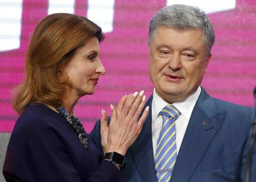 Ukrainian President Petro Poroshenko's wife Maryna stands with her husband at his headquarters after the second round of presidential elections in Kiev, Ukraine, Sunday, April 21, 2019. Ukrainian President Petro Poroshenko is accepting defeat in the election for the country's top post.