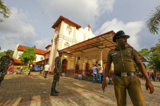 Sri Lankan army soldiers secure the area around St. Sebastian's Church damaged in blast in Negombo, north of Colombo, Sri Lanka, Sunday, April 21, 2019.  More than hundred were killed and hundreds more hospitalized with injuries from eight blasts that rocked churches and hotels in and just outside of Sri Lanka's capital on Easter Sunday, officials said, the worst violence to hit the South Asian country since its civil war ended a decade ago.
