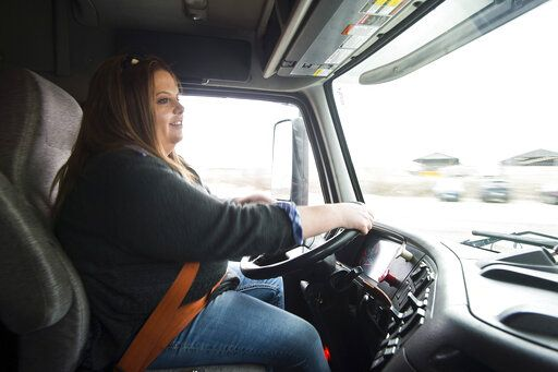 Heartland Community College CDL truck-driver training class student Holli Hays drives Wednesday, April 3, 2019, in Normal, Ill. (Lewis Marien/The Pantagraph via AP)