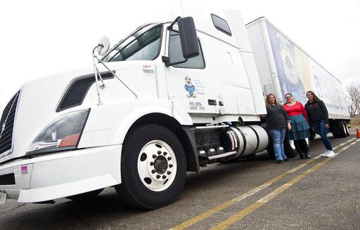 From left, Holli Hays, Daun Greif and Sevin Headley are the latest students to take on Heartland Community College's CDL truck-driver training class. They posed for a photograph before class Wednesday, April 3, 2019, in Normal, Ill. (Lewis Marien/The Pantagraph via AP)