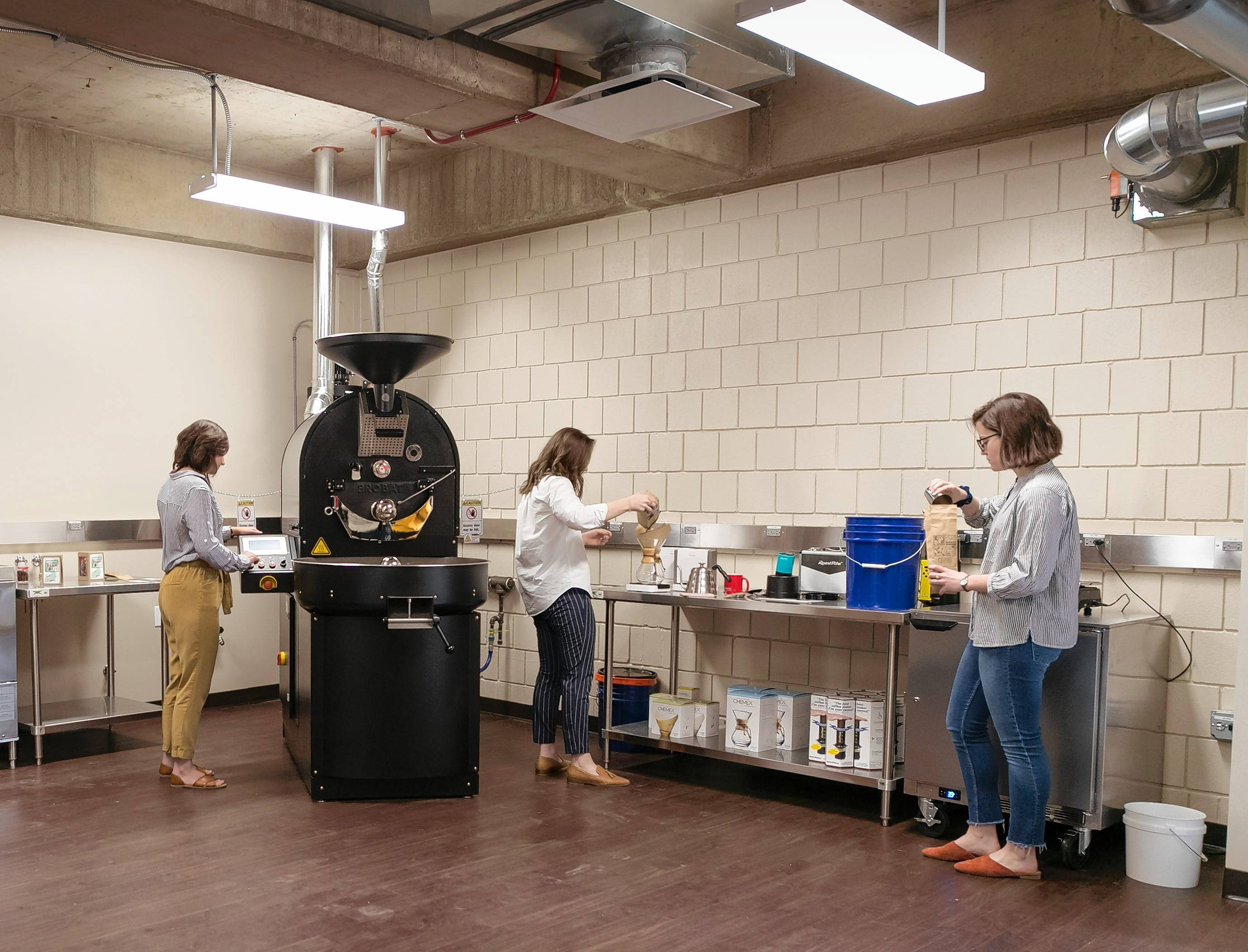 Students involved with North Central College's chapter of Enactus, an organization promoting social justice through entrepreneurship, work in the new on-campus Coffee Lab aimed at studying the industry.