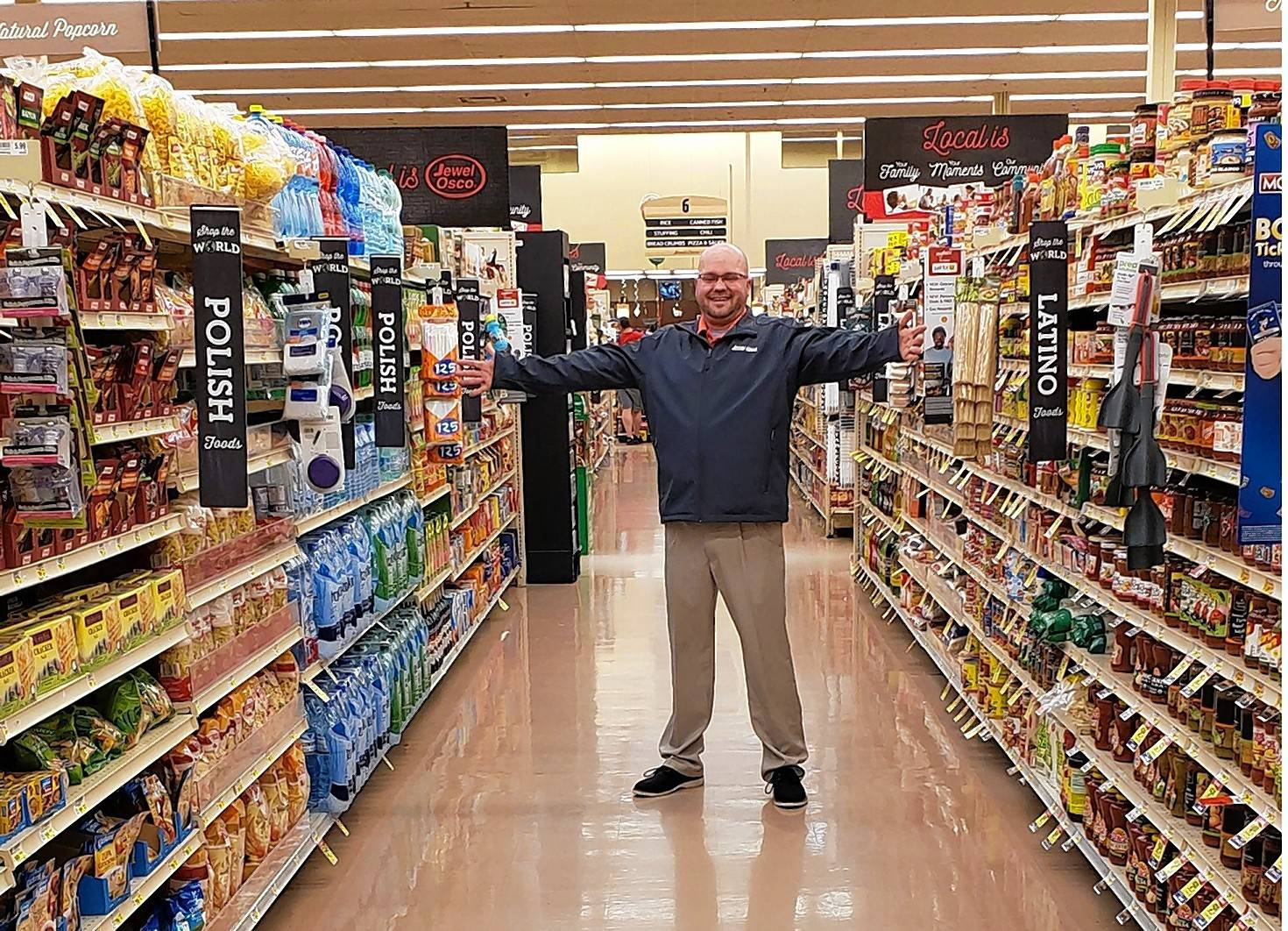Michael Korkosz, Natural/Organic/Specialty/Health/Ethnic (NOSHE) Sales Manager for Jewel-Osco, shows the food from around the world offered at Jewel-Osco.