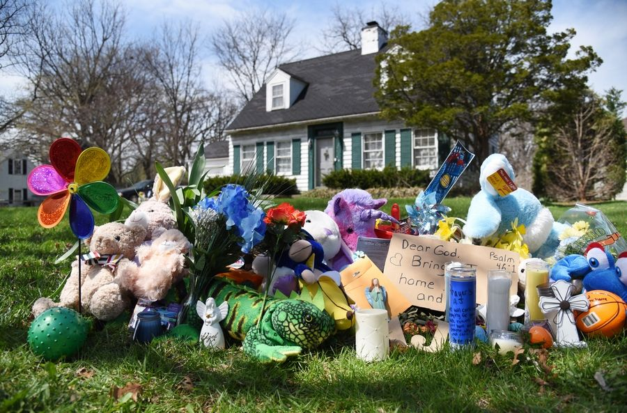 "A tribute grows Monday outside the Dole Avenue home of Andrew ""AJ"" Freund of Crystal Lake. Police continue their investigation to find the missing boy."