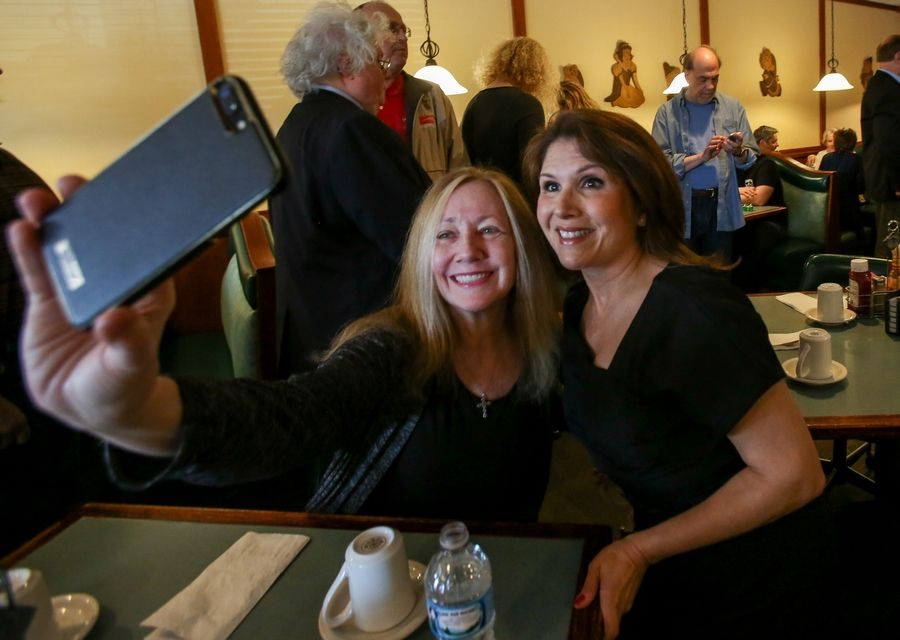 Friend and supporter Mandy Harneck of Glen Ellyn poses for a selfie with Evelyn Sanguinetti before the former lieutenant governor announced her candidacy for the 6th Congressional seat.