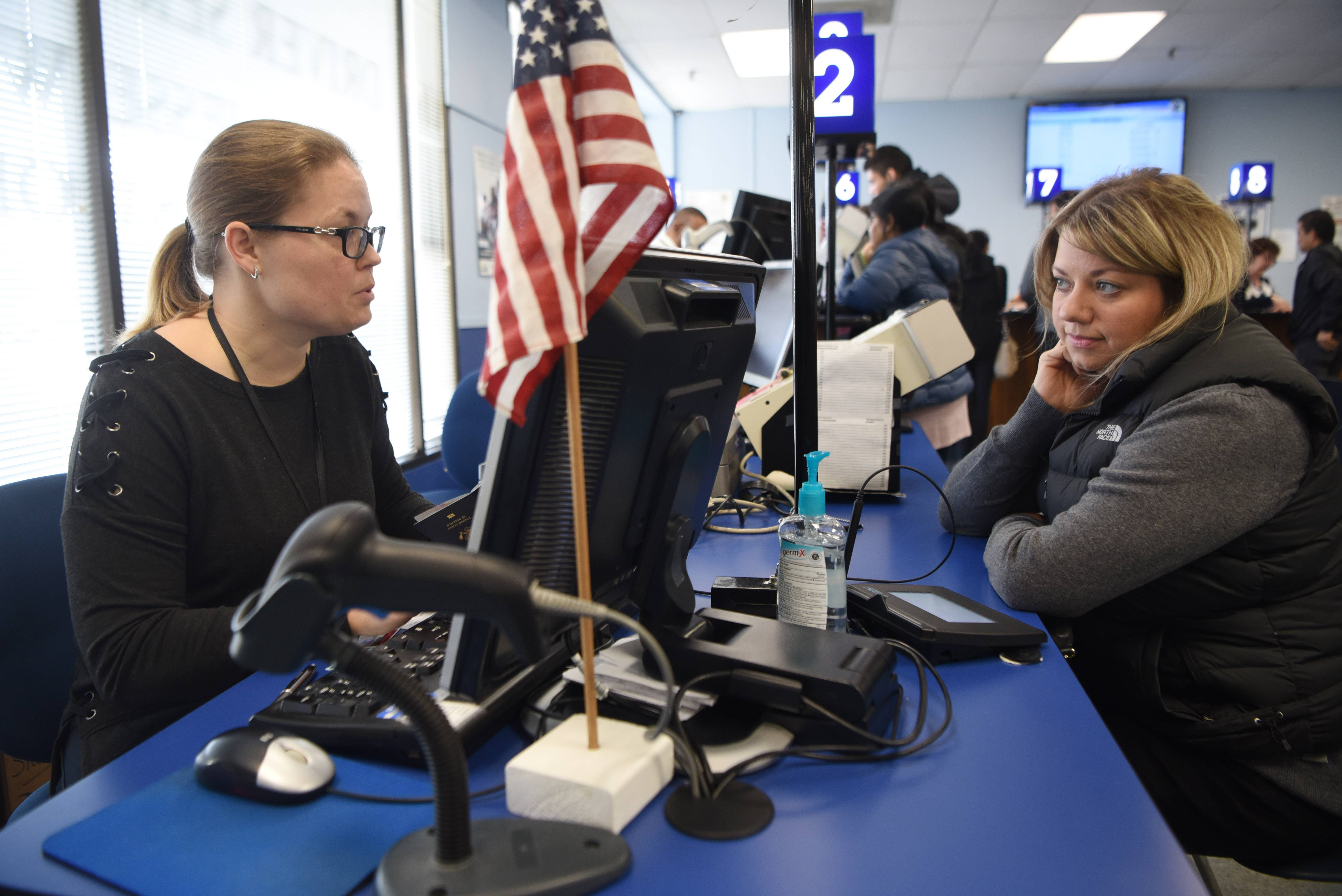 Kelly Hallman, right, of Bloomingdale applies for her REAL ID with the assistance of Urszula Kolodziej on Friday at the state driver's license facility in Schaumburg.
