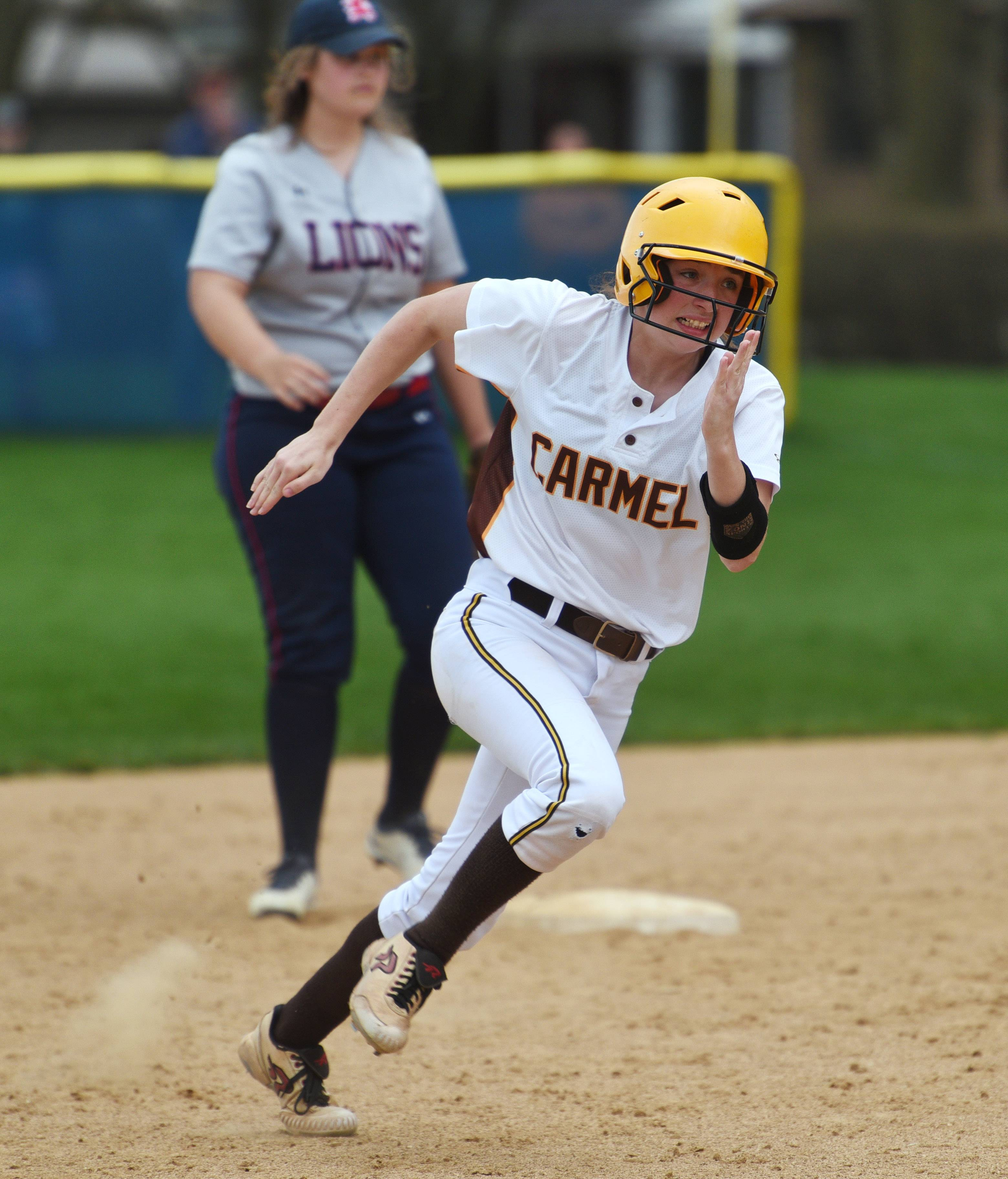 Carmel's Hailie Swiatkowski rounds second base, making it safely to third base, during Monday's softball game against St. Viator in Arlington Heights.