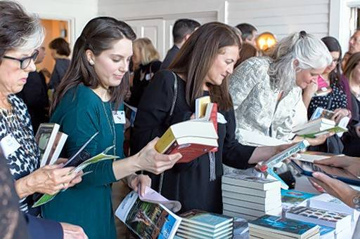 "Guests attend the book signing at a previous ""Novel Affair"" reception held by Ragdale, a nonprofit artists residency in Lake Forest. This year's reception will be held at 4 p.m. April 27 at Shoreacres in Lake Bluff."