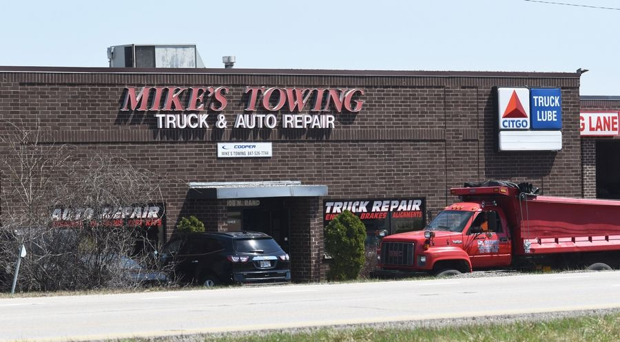 Current and former Island Lake officials are being sued over a contract with Mike's Towing of Wauconda. Mike's Towing is named in the lawsuit, too.