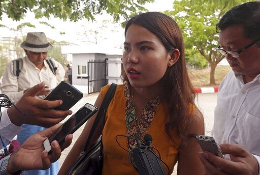 Chit Su Win, wife of Reuters journalist Kyaw Soe Oo, talks to journalists as she leaves the Supreme Court in Naypyitaw, Myanmar, Tuesday, April 23, 2019. Myanmar's Supreme Court on Tuesday rejected the final appeal of two Reuters journalists and upheld seven-year prison sentences for their reporting on the military's brutal crackdown on Rohingya Muslims.