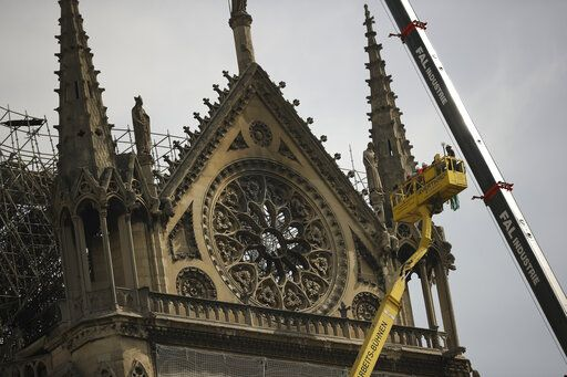 Technicians work in a crane next to the Notre Dame cathedral in Paris, Monday, April 22, 2019. n the wake of the fire last week that gutted Notre Dame, questions are being raised about the state of thousands of other cathedrals, palaces and village spires that have turned France - as well as Italy, Britain and Spain - into open air museums of Western civilization.