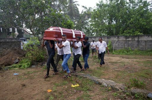 Relatives carry the coffin of Calistas Fernando for burial during the funerals of three people of the same family, all died at Easter Sunday bomb blast at St. Sebastian Church in Negombo, Sri Lanka, Monday, April 22, 2019. Easter Sunday bombings of churches, luxury hotels and other sites was Sri Lanka's deadliest violence since a devastating civil war in the South Asian island nation ended a decade ago.