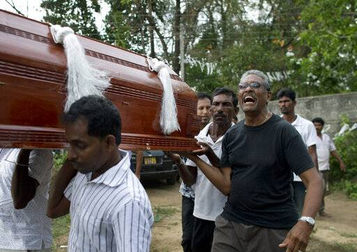 Auraj Fernando, right, mourns as he helps carry a coffin of one of three victims of his family who died at Easter Sunday bomb blast at St. Sebastian Church in Negombo, Sri Lanka, Monday, April 22, 2019. Easter Sunday bombings of churches, luxury hotels and other sites was Sri Lanka's deadliest violence since a devastating civil war in the South Asian island nation ended a decade ago.