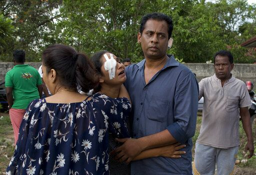 Delani Fernando, center and her husband Randima Fernando mourn the death of their son, 13-year old Anos Silva and his grandparents, after the Easter Sunday bomb blast at St. Sebastian Church in Negombo, Sri Lanka, Monday, April 22, 2019. Easter Sunday bombings of churches, luxury hotels and other sites was Sri Lanka's deadliest violence since a devastating civil war in the South Asian island nation ended a decade ago.