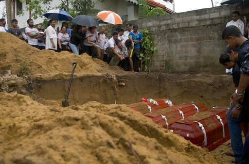 Relatives bury three members of the same family, all died at Easter Sunday bomb blast at St. Sebastian Church in Negombo, Sri Lanka, Monday, April 22, 2019. Easter Sunday bombings of churches, luxury hotels and other sites was Sri Lanka's deadliest violence since a devastating civil war in the South Asian island nation ended a decade ago.