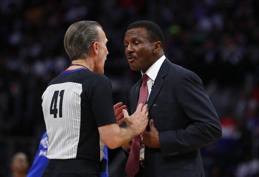 Detroit Pistons head coach Dwane Casey, right, talks with referee Ken Mauer during the second half of Game 4 of a first-round NBA basketball playoff series against the Milwaukee Bucks, Monday, April 22, 2019, in Detroit.