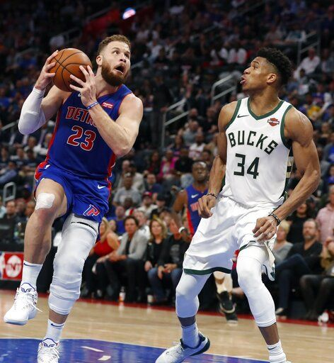 Detroit Pistons forward Blake Griffin (23) attempts a layup as Milwaukee Bucks forward Giannis Antetokounmpo (34) defends during the second half of Game 4 of a first-round NBA basketball playoff series, Monday, April 22, 2019, in Detroit.