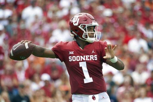 FILE - In this Oct. 6, 2018, file photo, Oklahoma quarterback Kyler Murray (1) throws a pass against Texas during the first half of an NCAA college football game at the Cotton Bowl, in Dallas. Murray is a possible pick in the 2019 NFL Draft. (AP Photo/Cooper Neill, File)