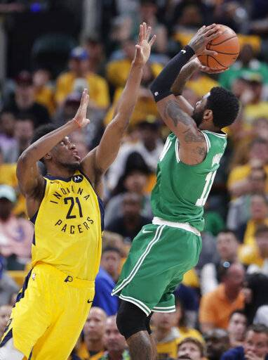Boston Celtics guard Kyrie Irving (11) shoots over Indiana Pacers forward Thaddeus Young (21) during the second half of Game 4 of an NBA basketball first-round playoff series in Indianapolis, Sunday, April 21, 2019. The Celtics defeated the Pacers 110-106 to win the series 4-0. (AP Photo/Michael Conroy)