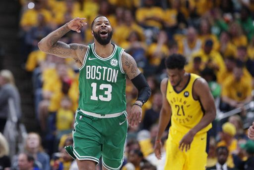 Boston Celtics forward Marcus Morris (13) celebrates during the second half of Game 4 against the Indiana Pacers in the NBA basketball first-round playoff series in Indianapolis, Sunday, April 21, 2019. The Celtics defeated the Pacers 110-106 to win the series 4-0.